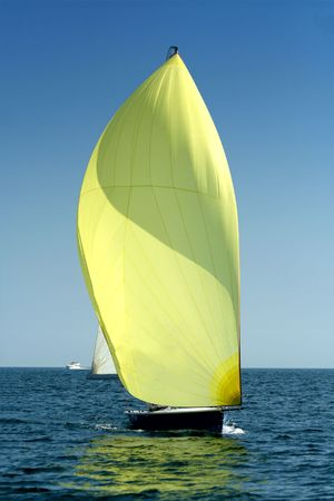 spinnaker: Sailing yacht with spinnaker in the wind  beautiful image