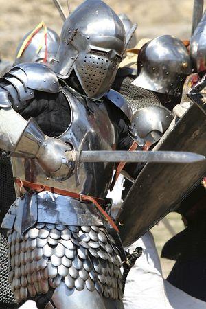 knight in armor: knight attacks  historical festival