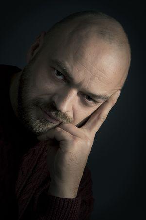 adult man portrait  on a dark background  european photo