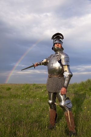bout: medieval knight in the field, and a rainbow   after the bout