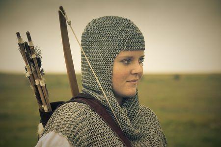bows woman  medieval armor  historical story   retro split toned photo