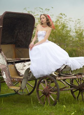 beautiful bride and old  carriage  retro style split toned photo