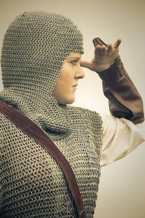 woman  medieval armor  historical story   retro split toned photo