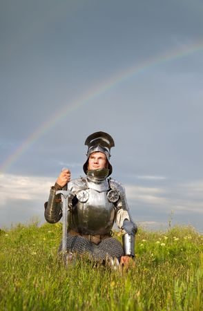 weary knight, after the battle /  rain and real rainbow photo
