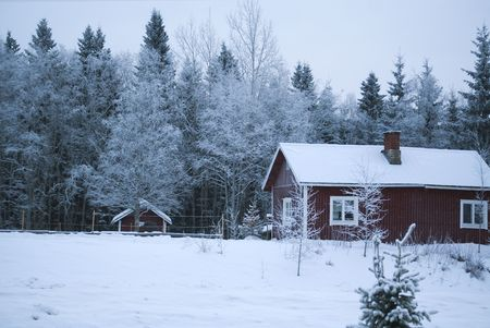 Village winter  Christmas  wooden house under snow  Finland photo
