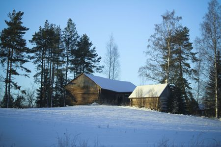 Winter Village  wooden buildings under snow  Finland photo
