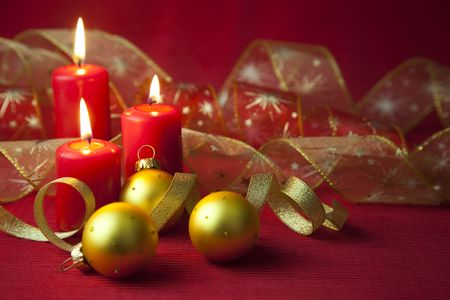 Christmas decoration with candles and ribbons  red and golden photo