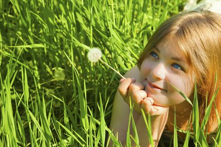 Girl with a Dandelion  against blue sky  freedom photo