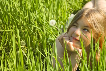 Girl with a Dandelion  in green meadow  freedom photo