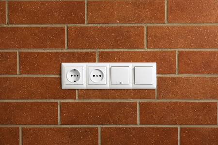 power outlets on the brick wall / horizontal / photo Stock Photo - 9417719