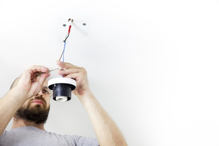 celling: Electrician Installing Celling Light  House worker  Repairman  wiht white copy space Stock Photo