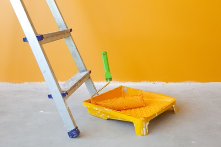 Home Improvement   ladder, paint can and paint roller photo