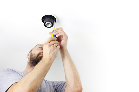 house worker: Electrician Installing Celling Light  House worker  Repairman  wiht white copy space Stock Photo