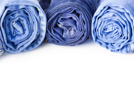 Rolls of Blue Jeans isolated on white background with copy space for your text photo