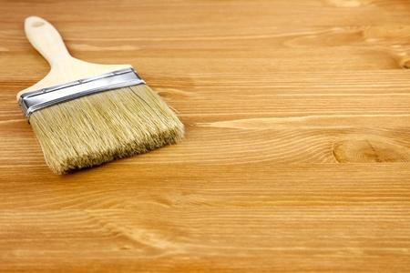 Wood texture and paintbrush  housework background photo