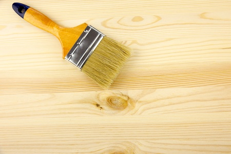 Wood texture and paintbrush  covering by varnish photo
