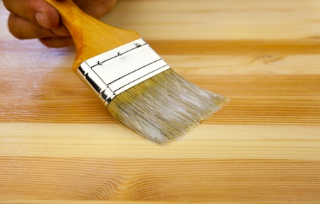 varnish: Wood texture, human hand and paintbrush  housework background Stock Photo