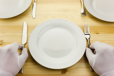 hotel kitchen: diner serving   crisis concept  put your text in the plate
