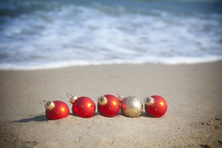 Christmas holiday  Baubles on the tropical beach photo