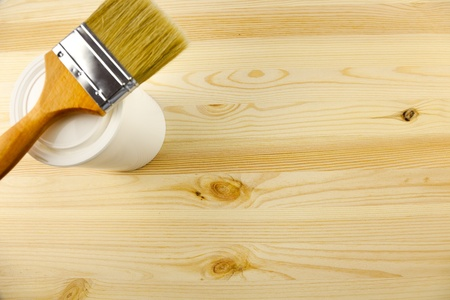 Wood texture and tin, paintbrush  covering by varnish photo