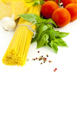 macaroni and cheese: Ingredients for Italian cooking: basil, tomato, parmesan, garlic and spaghetti   isolated on white Stock Photo