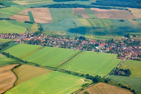 Aerial view of countryside with village and farmland photo
