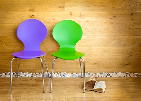 Green and Purple Chairs and opened Book / modern interior photo