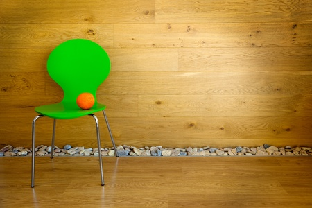 One green Chair and one Orange   empty room   modern interior Stock Photo - 12431832