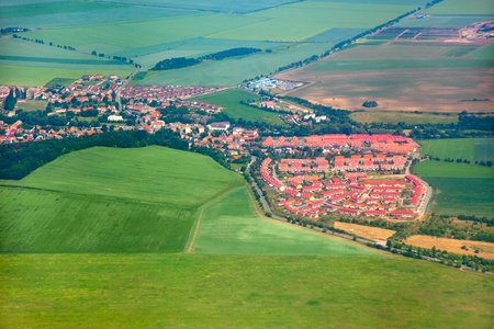 rural community: Aerial view of countryside with village and farmland Stock Photo
