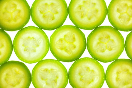Slices of zucchini or courgette isolated on white / back lit Stock Photo - 12795727