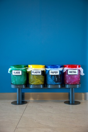 recycles: Colorful Recycle Bins in a Public place  vertical Stock Photo