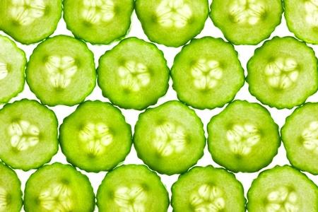 Slices of fresh Cucumber  background  back lit