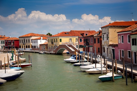 italian village: Canal with colorful houses  Italy, Venice, Veneto  nobody Stock Photo