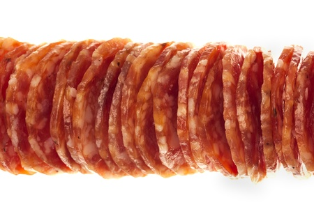 Salami  macro picture of few slices of salami isolated on white background photo