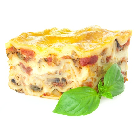 Home-baked hot Lasagne with fresh Basil  Isolated on white  Focus is all over Stock Photo