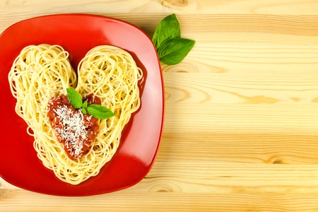 I love Pasta  Spaghetti on a plate and wooden table   Heart Shape