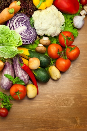 grocery shopping: Fresh Organic Vegetables   on the Wooden Desk  with Water Droplets