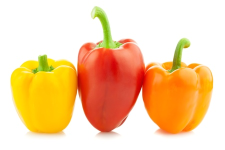 capsicums: Fresh Colored Peppers  Paprika  Isolated on a white background