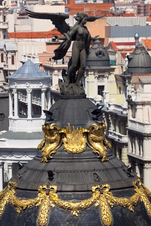 Aerial view of Madrid (Spain)  Famous sculpture and roofs of the city photo