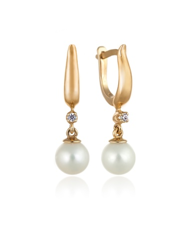 Pair of Beautiful Gold Earrings with Diamonds and Pearls   Isolated on White background photo