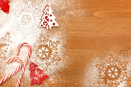 brown sugar: Christmas background with Candies, snowflakes and decorative Christmas Tree on wooden table with copy space for your text