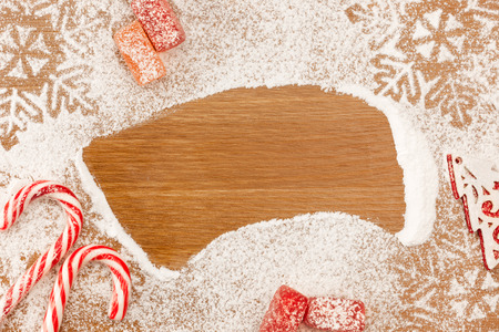 Christmas background with Candies, snowflakes and decotative Christmas Tree on wooden table with copy space Stock Photo - 23863739