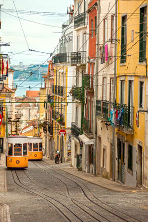 electric tram: Two Yellow Historic Lisbon
