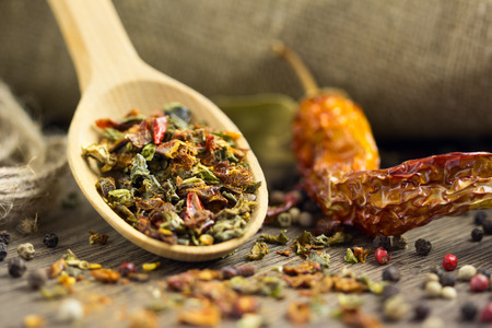 Natural spices in the wooden spoon with dry chilli photo
