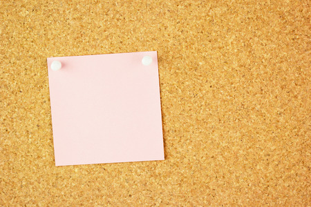 Pink clear sticker pined on the corkboard   your text  photo