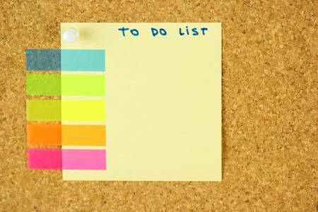 cork sheet: To do list schedule sticker pined on the corkboard