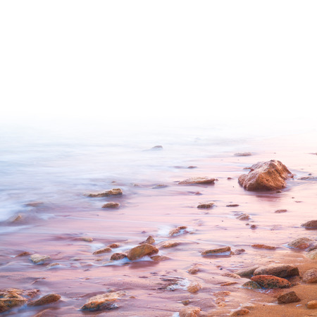 Smooth Sea and Stones on Sunrise - with white area for text photo