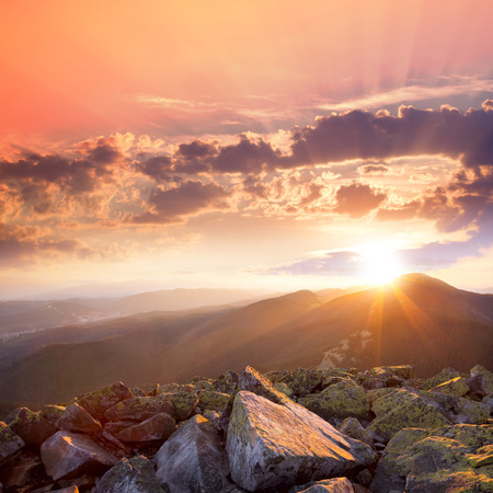Sunset in the mountains landscape, Dramatic sky,  colorful stones and sunbeams in Carpathians, Ukraine, Europe photo