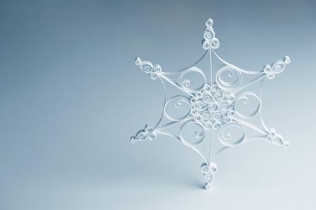 Handmade quilling beautiful white paper Snowflake - Christmas decoration photo