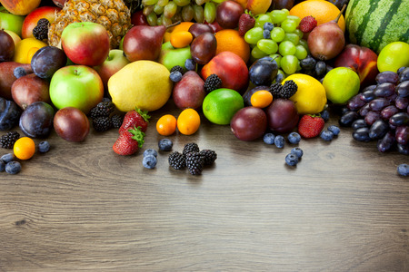 Big assortment of Fresh Organic Fruits, frame composition on wooden table photo